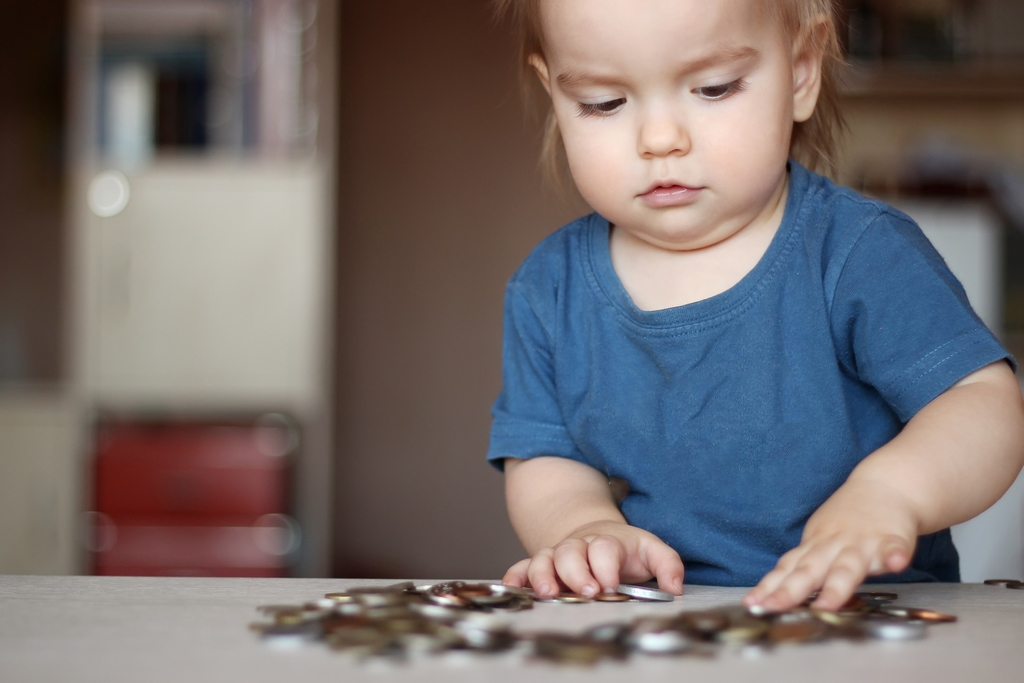 a-child-with-coins